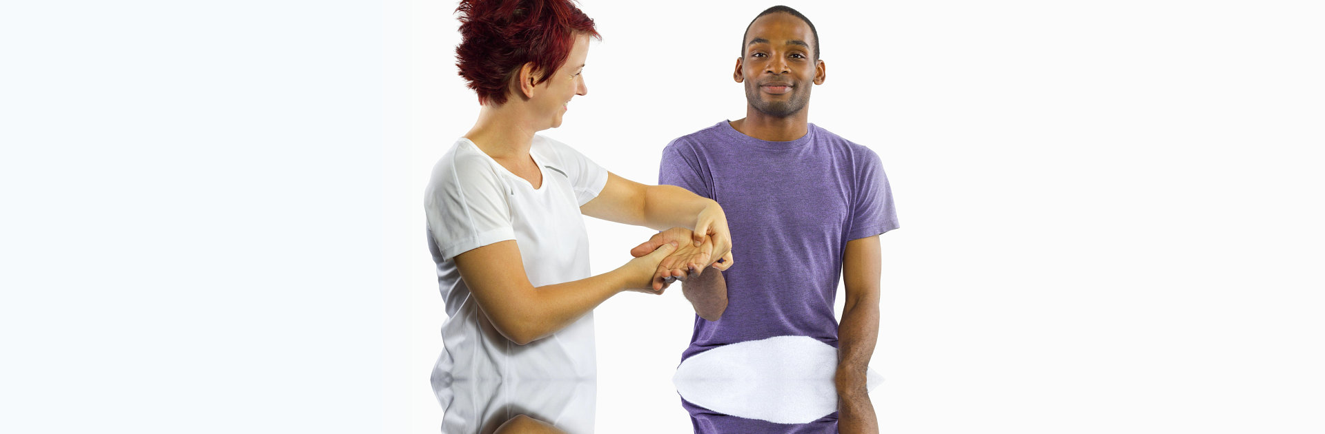Young female masseuse applying pressure on male client's hand
